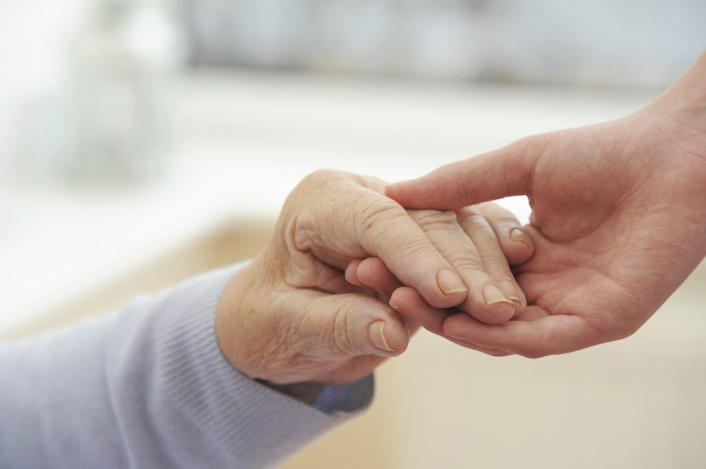 An image of two hands: there may be testing times ahead for the Third Sector