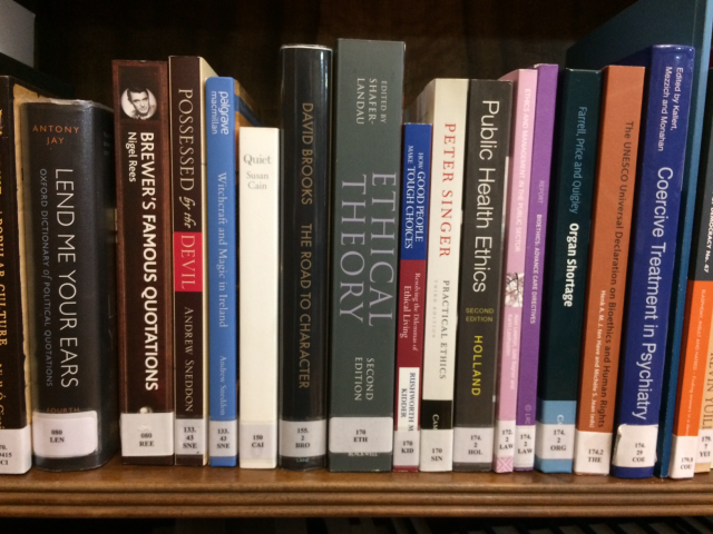 A photograph showing a selection of titles from the 100 classification in the Assembly Library; in the Dewey Decimal system, 100 is used to classify philosophy and psychology